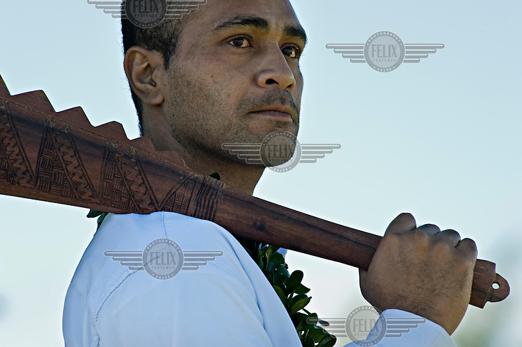 The guard of a nobleman at the coronation of King George Tupou V. He holds a puo, or club, on his shoulder that in ancient times would have been used to split the skull of anyone who upset proceedings.