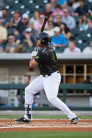 Daniel Fields (5) of the Charlotte Knights follows through on his swing against the Columbus Clippers at BB&T BallPark on May 3, 2016 in Charlotte, North Carolina.  The Clippers defeated the Knights 8-3.  (Brian Westerholt/Four Seam Images)