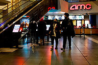 NEW YORK, NEW YORK - MARCH 05: People walk in AMC Cinema in Times Square on March 05, 2021, in New York. NY Governor, Andrew Cuomo gave the permission to reopen cinemas on Feb. 22 at 25% capacity, or a maximum of 50 people per show. (Photo by John Smith/VIEWpress)