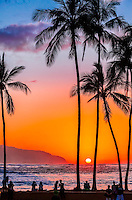 Locals and tourists alike watch the sun set from Hale'iwa Beach Park, North Shore, O'ahu.