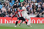 Real Madrid's Karim Benzema and Athletic Club de Bilbao's Iker Muniain during La Liga match between Real Madrid and Athletic Club de Bilbao at Santiago Bernabeu Stadium in Madrid, Spain. April 21, 2019. (ALTERPHOTOS/A. Perez Meca)