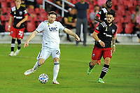 WASHINGTON, DC - SEPTEMBER 27: Tommy McNamara #26 of New England Revolution passes off the ball during a game between New England Revolution and D.C. United at Audi Field on September 27, 2020 in Washington, DC.