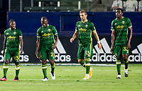 CARSON, CA - OCTOBER 07: Yimmi Chara #23 of the Portland Timbers  scores a goal and celebrates with teammates Diego Chara #21, Dario Zuparic #13, Larrys Mabiala #33 during a game between Portland Timbers and Los Angeles Galaxy at Dignity Heath Sports Park on October 07, 2020 in Carson, California.