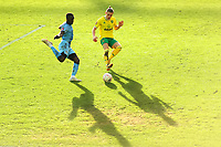 9th January 2021; Carrow Road, Norwich, Norfolk, England, English FA Cup Football, Norwich versus Coventry City; Przemysław Placheta of Norwich City challenges Julien Dacosta of Coventry City in low winter sunlight