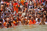the naga baba approch Har Ki Pauri.ghat  in Hariwar India to take the holy bath into Ganga river to take human out of the circle of life & death ( stage known as Moksha )