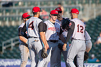 Arkansas Travelers manager Mitch Canham (12) visits the mound to take pitcher Andrew Moore (18) from the game during a Texas League game between the Northwest Arkansas Naturals and the Arkansas Travelers on May 30, 2019 at Arvest Ballpark in Springdale, Arkansas. (Jason Ivester/Four Seam Images)