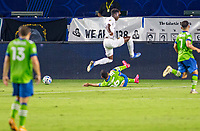 CARSON, CA - SEPTEMBER 27: Alex Roldan #16 of the Seattle Sounders slide tackles Diedie Traore #19 of the Los Angeles Galaxy during a game between Seattle Sounders FC and Los Angeles Galaxy at Dignity Heath Sports Park on September 27, 2020 in Carson, California.