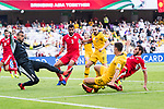 Goalkeeper Amer Shafi of Jordan (L) saves the attempt by Chris Ikonomidis of Australia (2nd R) as during the AFC Asian Cup UAE 2019 Group B match between Australia (AUS) and Jordan (JOR) at Hazza Bin Zayed Stadium on 06 January 2019 in Al Ain, United Arab Emirates. Photo by Marcio Rodrigo Machado / Power Sport Images