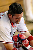 16 June 2006: Brian Schneider, catcher for the Washington Nationals, adjusts his gear in the dugout during a break in the action against the New York Yankees at RFK Stadium, in Washington, DC. The Yankees defeated the Nationals 7-5 in the first meeting of the two franchises...Mandatory Photo Credit: Ed Wolfstein Photo...