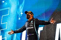 28th March 2021; Sakhir, Bahrain; F1 Grand Prix of Bahrain, Race Day;   HAMILTON Lewis gbr, Mercedes AMG F1 GP W12 E Performance, celebrates his win on the podium during Formula 1 Gulf Air Bahrain Grand Prix