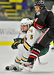 27 January 2012: University of Vermont Catamount forward Colin Markison, a Freshman from Princeton, NJ, is checked by Northeastern University Husky defenseman Dan Cornell, a Freshman from Abington, MA, at Gutterson Fieldhouse in Burlington, Vermont. The Catamounts fell to the Huskies 8-3 in the first game of their 2-game Hockey East weekend series. Mandatory Credit: Ed Wolfstein Photo