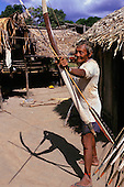Koatinemo village, Brazil. Assurini man demonstrating bow and arrow.