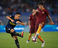 Calcio, Serie A: Roma vs Inter. Roma, stadio Olimpico, 2 ottobre 2016.<br /> FC Inter's Yuto Nagatomo, left, and Roma's Diego Perotti fight for the ball during the Italian Serie A football match between Roma and FC Inter at Rome's Olympic stadium, 2 October 2016.<br /> UPDATE IMAGES PRESS/Isabella Bonotto