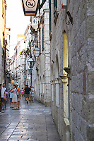 The narrow Od Puca shopping street with tourists and old buildings Dubrovnik, old city. Dalmatian Coast, Croatia, Europe.