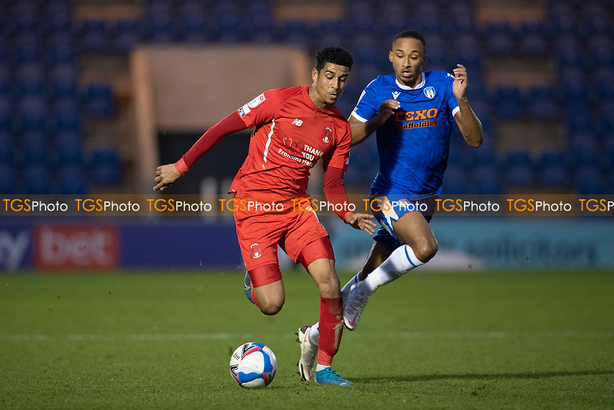 Louis Dennis, Leyton Orient under pressure from Cohen Bramall, Colchester United during Colchester United vs Leyton Orient, Sky Bet EFL League 2 Football at the JobServe Community Stadium on 14th November 2020