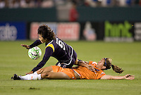 Sky Blue midfielder Jen Buczkowski takes down LA Sol forward Han Duan. The LA Sol defeated Sky Blue FC1-0 at Home Depot Center stadium in Carson, California on Friday May 15, 2009.   .