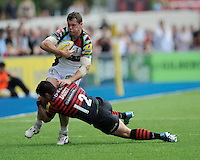 Tim Molenaar of Harlequins is tackled by Brad Barritt of Saracens during the Aviva Premiership semi final match between Saracens and Harlequins at Allianz Park on Saturday 17th May 2014 (Photo by Rob Munro)
