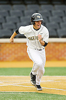 Andrew Williams (16) of the Wake Forest Demon Deacons hustles down the first base line against the Western Carolina Catamounts at Wake Forest Baseball Park on March 26, 2013 in Winston-Salem, North Carolina.  The Demon Deacons defeated the Catamounts 3-1.  (Brian Westerholt/Four Seam Images)