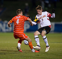 Jack Metcalf (4) of Clemson collides with Alex Shinsky (9) of Maryland during the game at the Maryland SoccerPlex in Germantown, MD. Maryland defeated Clemson, 1-0, in overtime.  With the win the Terrapins advanced to the finals of the ACC men's soccer tournament.