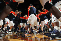 Dec. 20, 2010; Charlottesville, VA, USA; Virginia Cavalier teammates huddle before the start of the game against the Norfolk State Spartans at the John Paul Jones Arena. Mandatory Credit: Andrew Shurtleff