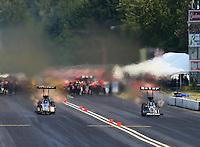 Aug. 2, 2014; Kent, WA, USA; NHRA top fuel dragster driver Khalid Albalooshi (left) races alongside teammate Shawn Langdon during qualifying for the Northwest Nationals at Pacific Raceways. Mandatory Credit: Mark J. Rebilas-