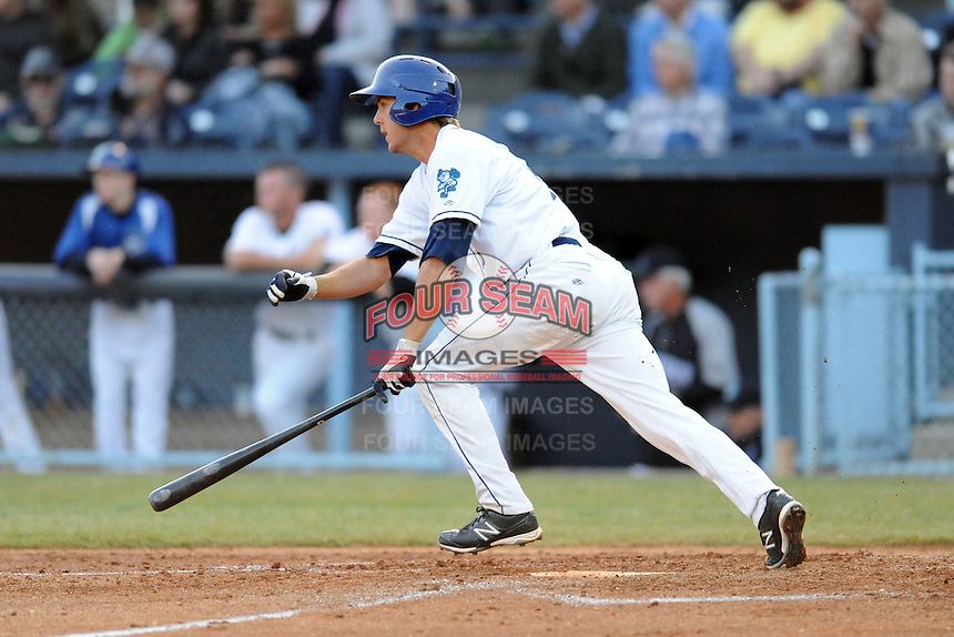 Asheville Tourists catcher Will Swanner #8 swings at a pitch during a game between the West Virginia Power and the Asheville Tourists at McCormick Field, Asheville, North Carolina April 9, 2012. The Tourists won 13-5  8-4  (Tony Farlow/Four Seam Images)..