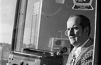 """Claude Mouton au Parc Jarry en juillet 1973 (date exacte inconnue).<br /> <br /> Claude Mouton travailla pour les Expos jusqu'en 1973, alors qu'il quitta le club, et concentra ses énergies dans la fonction d'annonceur maison pour les matchs du club de hockey """"Les Canadiens de Montréal"""", poste qu'il exerçait depuis 1969. <br /> <br />  <br /> <br /> <br /> PHOTO : Alain Renaud<br />  - Agence Quebec Presse"""