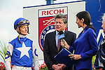 """Toronto, ON - September  17:   Robert """"Bat"""" Masterson (Centre) and Julien R. Leparoux (Left) in the winner's circle  at the Ricoh Woodbine Mile Stakes  at Woodbine Race Course on September 17, 2016 in Toronto, Ontario. (Photo by Sophia Shore/Eclipse Sportswire/Getty Images)"""