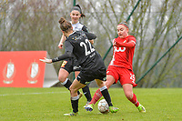 Davinia Vanmechelen (25) of Standard and Justine Blave (22) of Eendracht Aalst pictured during a female soccer game between Standard Femina de Liege and Eendracht Aalst on the 12 th matchday of the 2020 - 2021 season of Belgian Scooore Womens Super League , saturday 30 th of January 2021 in Angleur , Belgium . PHOTO SPORTPIX.BE   SPP   STIJN AUDOOREN