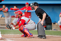 Williamsport Crosscutters catcher Francisco Diaz #2 and umpire Jeff Andrews during the second game of a doubleheader against the Batavia Muckdogs at Dwyer Stadium on August 23, 2011 in Batavia, New York.  Batavia defeated Williamsport 2-1.  (Mike Janes/Four Seam Images)