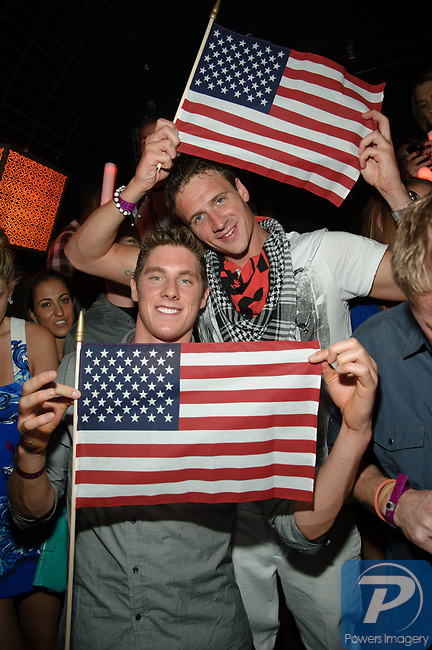 Ryan Lochte, continues his celebration at LAVO Nightclub Las Vegas, with fellow gold medalists swim team mates, Conor Dwyer, and Cullen Jones, August 17, 2012  © Al Powers, PowersImagery.com