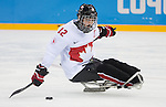 Sochi, RUSSIA - Mar 11 2014 -  Greg Westlake takes a shot as Canada takes on Czech Republic in Sledge Hockey at the 2014 Paralympic Winter Games in Sochi, Russia.  (Photo: Matthew Murnaghan/Canadian Paralympic Committee)