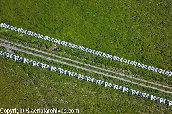 aerial photograph of a white fence adjoining a driveway on Sonoma Mountain, Petaluma, California in spring