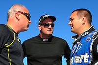Aug. 21, 2011; Brainerd, MN, USA: NHRA top fuel dragster driver Cory McClenathan (left) talks with Bob Vandergriff Jr (center) and Brandon Bernstein during the Lucas Oil Nationals at Brainerd International Raceway. Mandatory Credit: Mark J. Rebilas-