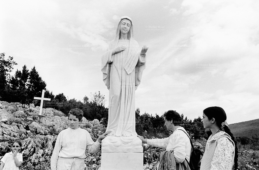 Bosnia. Medjugorje. Podbrdo, also called the Apparition Hill, is the place above the village of Bijakovici near Medjugorje where the six visonaries in the first days saw the Virgin Mary. Since then it is here that the pilgrims gather for prayer of the rosary. On september 8 2001by a gift of koreans pilgrims, a statue of the Queen of Peace, the Virgin Mary, was erected and blessed at this place. © 2002 Didier Ruef