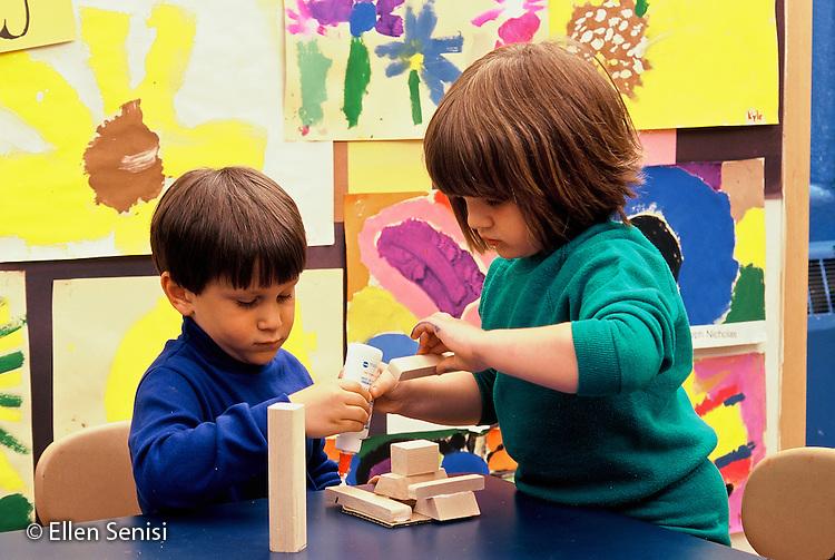 MR / Schenectady, NY.Yates Arts Magnet School / Pre-K.Students cooperate on art project gluing blocks together. (girl; 4; boy: 4) (PK- orginal).MR: Dob1, Edw5.© Ellen B. Senisi
