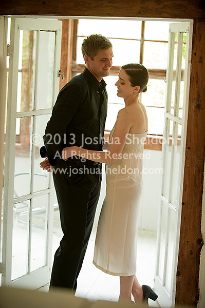Young couple flirting by open French doors