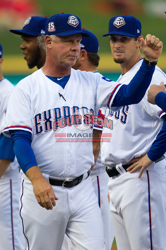 Round Rock Express manager Steve Buechele #22 is greeted by his team during the pre game introductions before Pacific Coast League baseball game against the Oklahoma City Redhawks on April 3, 2014 at the Dell Diamond in Round Rock, Texas. The Redhawks defeated the Express 7-6 in the season opener for both teams. (Andrew Woolley/Four Seam Images)