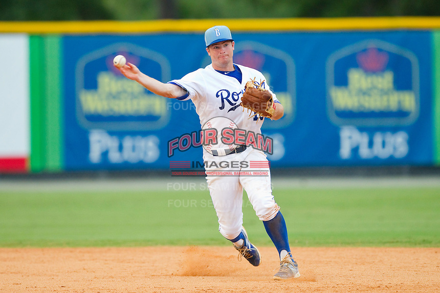 Burlington Royals shortstop Andrew Ayers (18) makes a throw to first base against the Elizabethton Twins at Burlington Athletic Park on August 11, 2013 in Burlington, North Carolina.  The Twins defeated the Royals 12-5.  (Brian Westerholt/Four Seam Images)
