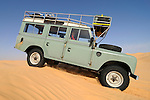 Africa, Tunisia, nr. Tembaine. Desert travellers Andrea and Stephan driving their 1975 Land Rover Series 3 Station Wagon through a sandfield close to Tembaine on the eastern edge of the Grand Erg Oriental. --- No releases available, but releases may not be needed for certain uses. Automotive trademarks are the property of the trademark holder, authorization may be needed for some uses.  --- Info: Image belongs to a series of photographs taken on a journey to southern Tunisia in North Africa in October 2010. The trip was undertaken by 10 people driving 5 historic Series Land Rover vehicles from the 1960's and 1970's. Most of the journey's time was spent in the Sahara desert, especially in the area around Douz, Tembaine, Ksar Ghilane on the eastern edge of the Grand Erg Oriental.