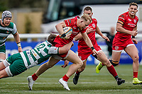 Will Homer of Jersey Reds is tackled by Harry Sloan of Ealing Trailfinders during the Championship Cup QF match between Ealing Trailfinders and Jersey Reds at Castle Bar, West Ealing, England  on 22 February 2020. Photo by David Horn.