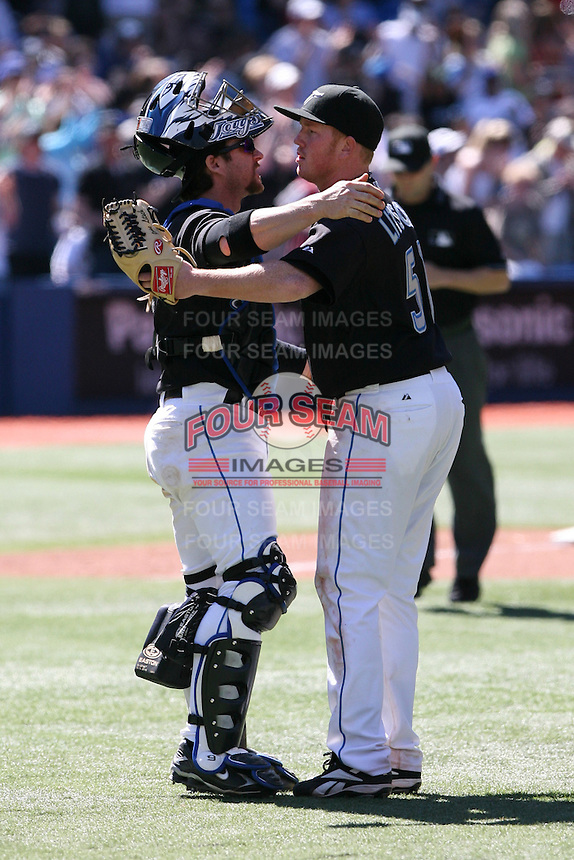 May 24th 2009:  Starting pitcher Jesse Litsch (51) and Gregg Zaun (9) of the Toronto Blue Jays during a game at the Rogers Centre in Toronto, Ontario, Canada .  Photo by:  Mike Janes/Four Seam Images