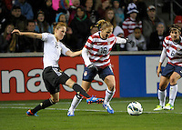 US defender Rachel Buehler (16) avoids the takeaway attempt by German defender Verena Faibt (15).  The U.S. Women's National Team tied Germany 1-1 in a friendly at Toyota Park in Bridgeview, IL on October 20, 2012.