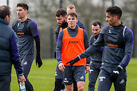 Tuesday 17 January 2017<br /> Pictured: Tom Carrol looks own during training. <br /> Re:Swansea City training session at the Fairwood Training ground, Fairwood, Swansea, Wales, UK