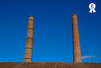 Two chimneys against blue sky Frances, Landes (Licence this image exclusively with Getty: http://www.gettyimages.com/detail/74583319 )