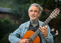 Stephen Lyman, musician, specialist of the Bach Lute Suites, playing outside St Gervais and St Protais church, Paris close to Pont Louis Phillipe, to the north of Ile St Louis. Friday 12th October 2012.