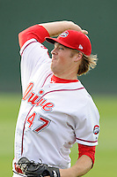 Pitcher Ty Buttrey (47) of the Greenville Drive warms up before a game against the Lexington Legends on Tuesday, April 14, 2015, at Fluor Field at the West End in Greenville, South Carolina. Lexington won, 5-3. (Tom Priddy/Four Seam Images)