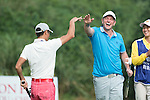 Lee Sharpe (right) and Xing Aowei (pink pants) at the end of their game during the World Celebrity Pro-Am 2016 Mission Hills China Golf Tournament on 23 October 2016, in Haikou, Hainan province, China. Photo by Weixiang Lim / Power Sport Images