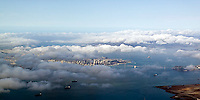 aerial photograph as fog burns off San Francisco skyline