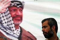 "Khaled Abu Hilal Secretary-General of the Fatah movement Al Yasser look at The late Palestinian President Yasser Arafat threw rally help by Fatah Al Yasser movement in Gaza City, Tuesday, Aug. 7, 2007.""photo by Fady Adwan"""""